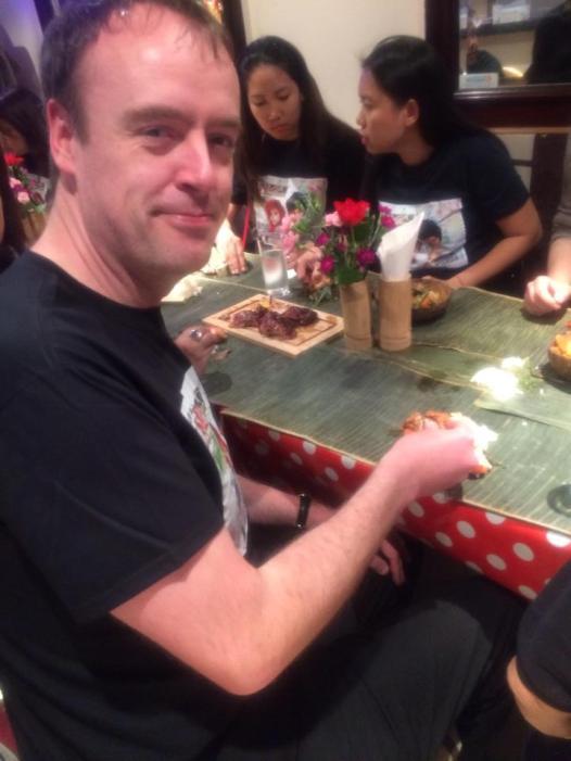Malcolm Eating Filipino Food Kamayan Style.